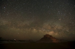 The Milky Way is seen in the night sky over rocks in the White Desert north of the Farafra Oasis.